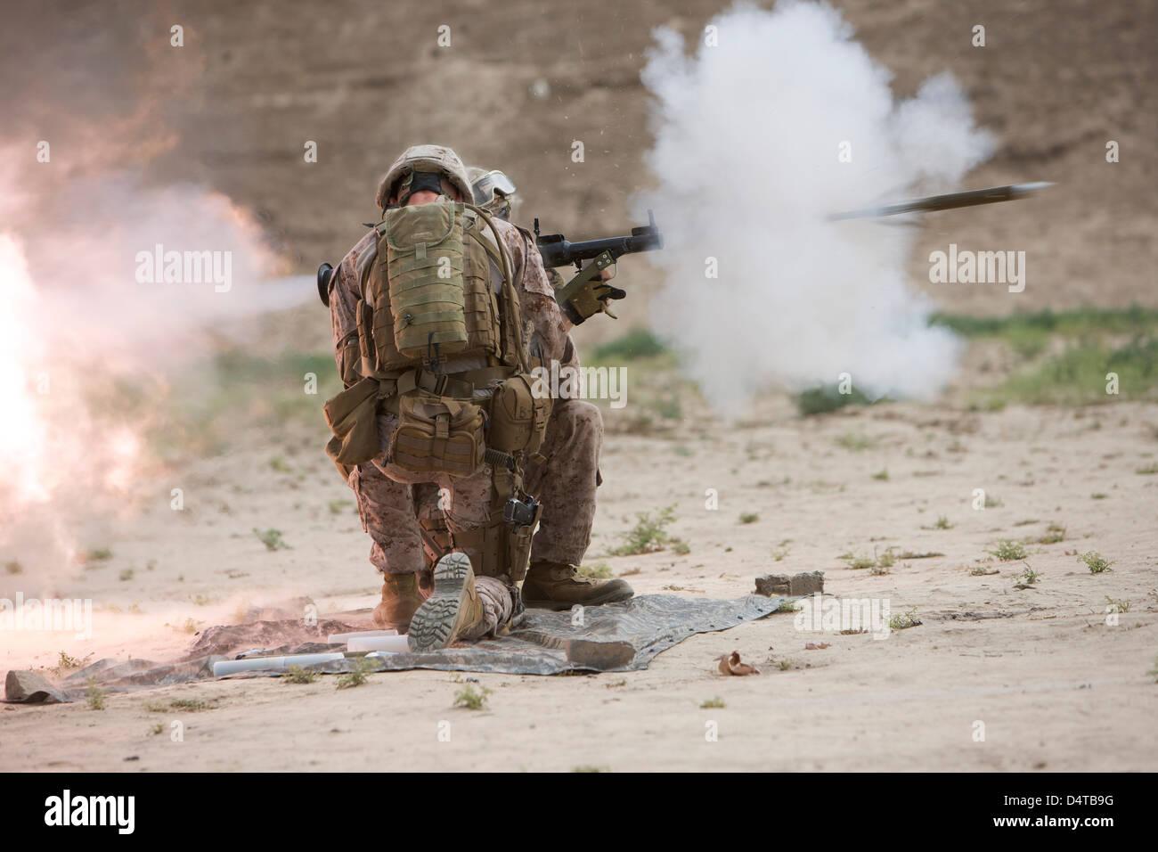 U.S. Marine fires a rocket-propelled grenade launcher. - Stock Image