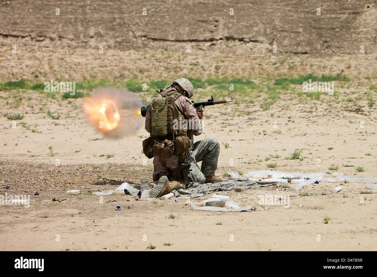 U.S. Army soldier fires a rocket-propelled grenade launcher. - Stock Image