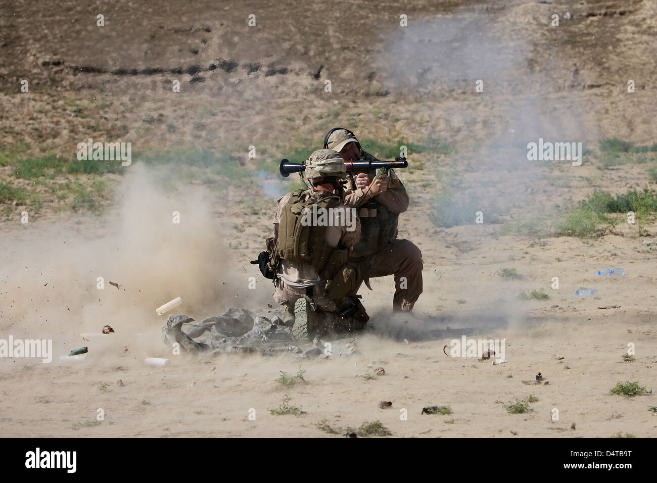 A U.S. Contractor fires a rocket-propelled grenade launcher. - Stock Image