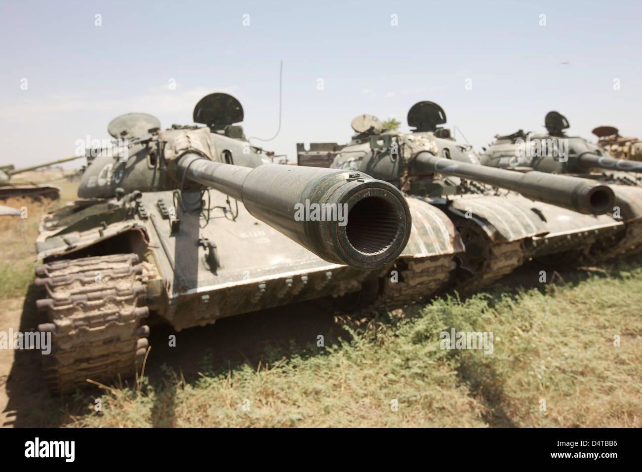 Russian T-54 and T-55 main battle tanks rest in an armor junkyard in Kunduz, Afghanistan. - Stock Image