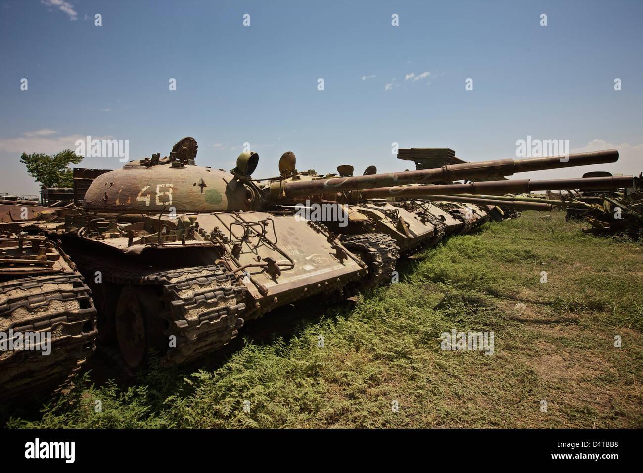 Russian T-62 main battle tanks rest in an armor junkyard in Kunduz, Afghanistan. - Stock Image