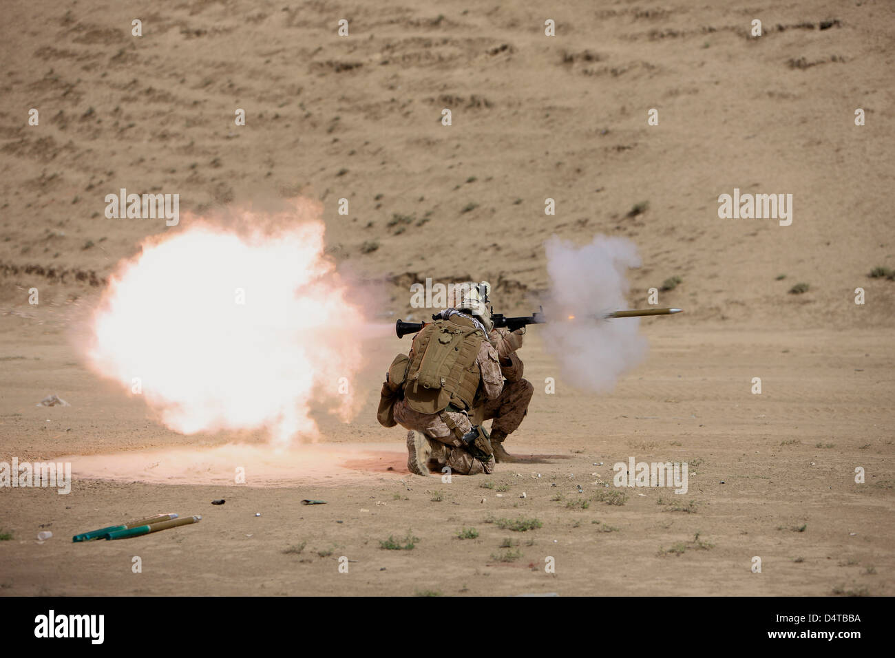 U.S. Marine fires a HE fragmentation round from the RPG-7 rocket-propelled grenade launcher in a wadi near Kunduz, - Stock Image