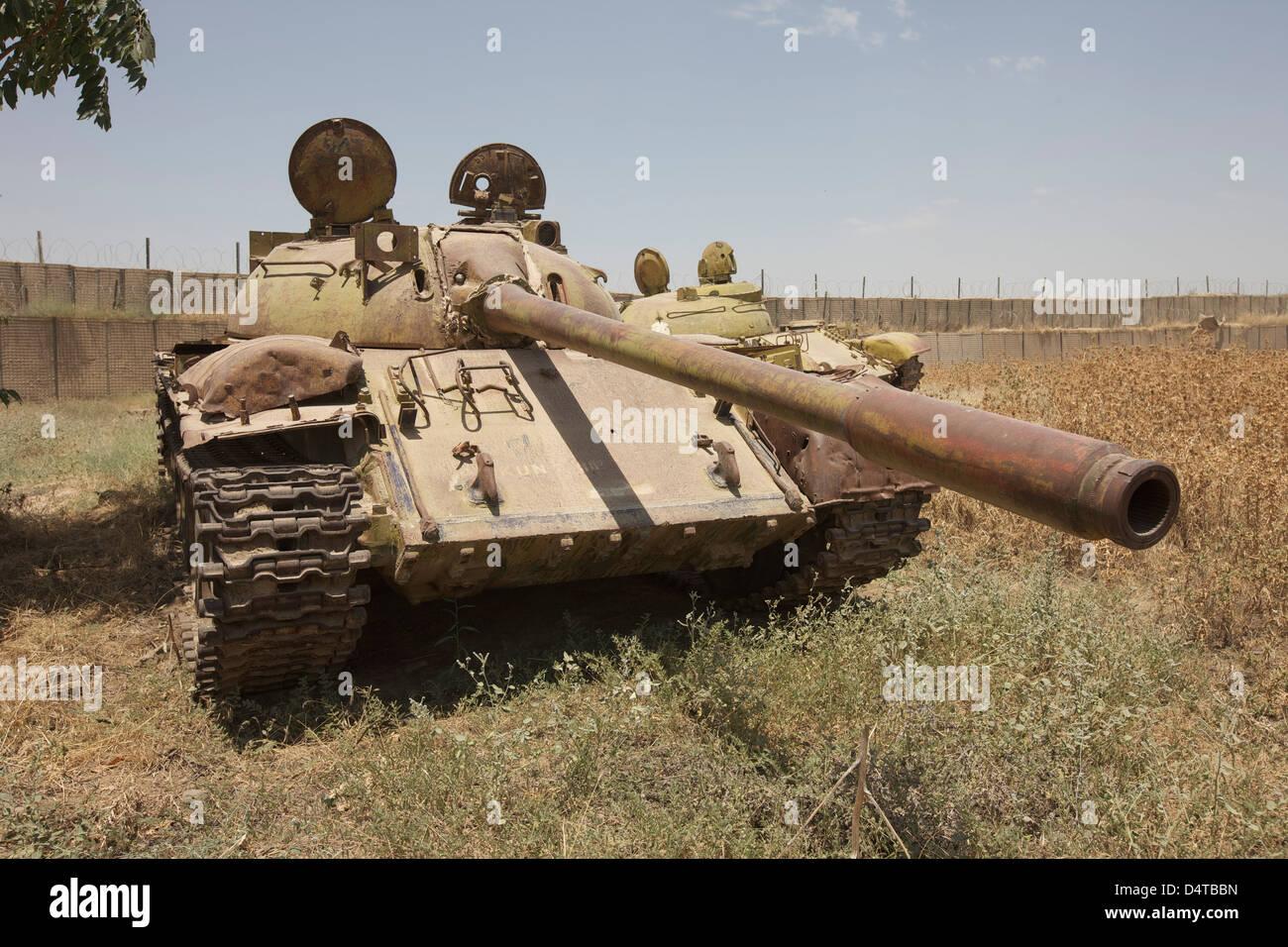 A Russian T-55 main battle tank rests in an armor junkyard in Kunduz, Afghanistan. - Stock Image