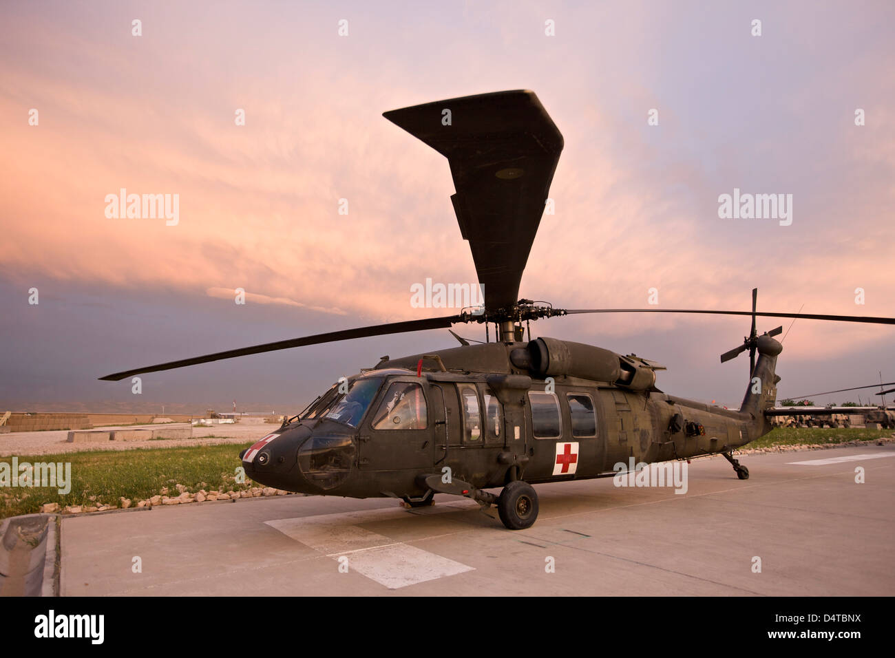 A UH-60L Black Hawk medevac helicopter parked on its pad at the German PRT in Northern Afghanistan. - Stock Image