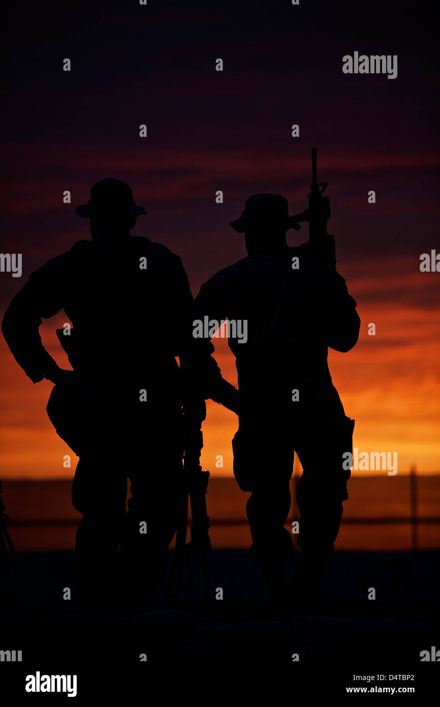Silhouette of U.S Marines on a bunker at sunset in Northern Afghanistan. Stock Photo