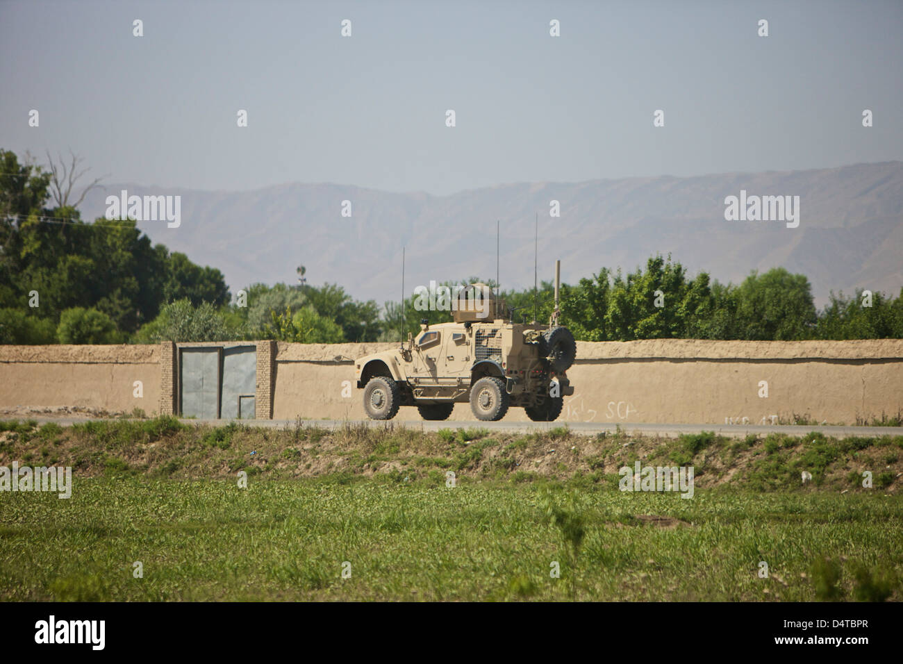 An M-ATV driving south on A7 towards Aliabad from Kunduz, Afghanistan. - Stock Image