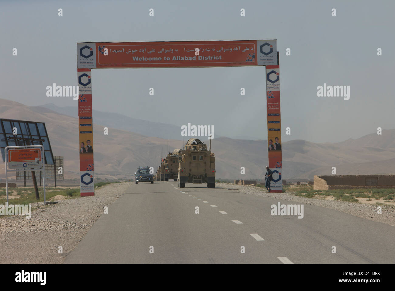 A convoy of U.S. Navy EOD Cougar MRAPs driving south on A7 towards Aliabad from Kunduz, Afghanistan. - Stock Image