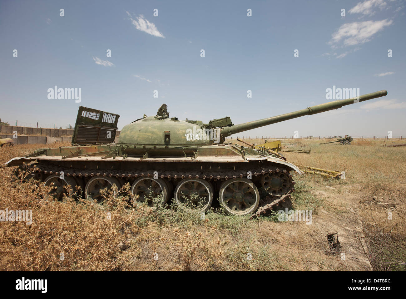 A Russian T-62 main battle tank rest in an armor junkyard in Kunduz, Afghanistan. - Stock Image