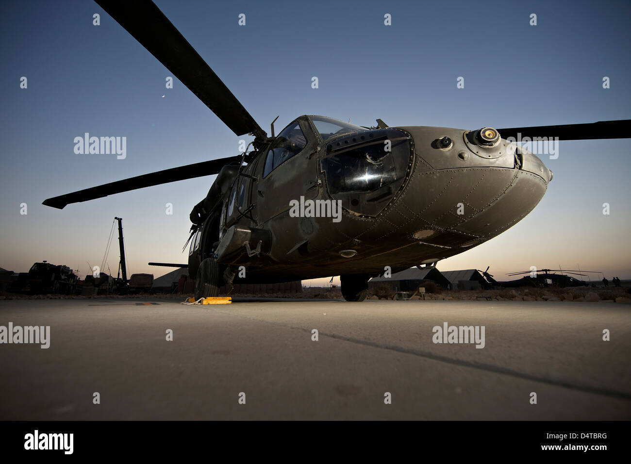 A UH-60L Blackhawk sits on its pad at the German PRT in Afghanistan. - Stock Image