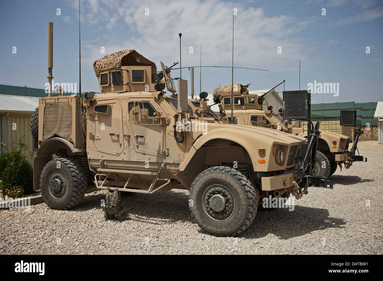 An Oshkosh M-ATV MRAP (Mine Resistant Ambush Protected) parked at a military base in Afghanistan. - Stock Image