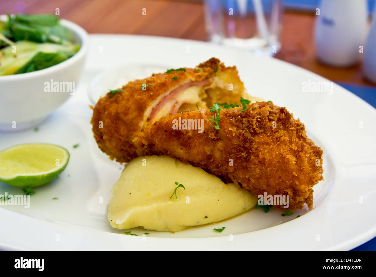 Chicken Cordon bleu with mash potato and salad - Stock Image