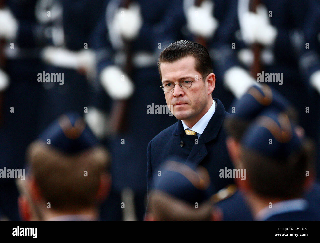 Germany?s Minister of Defence Karl-Theodor zu Guttenberg walks the guard of honour at the air base in Noervenich, - Stock Image