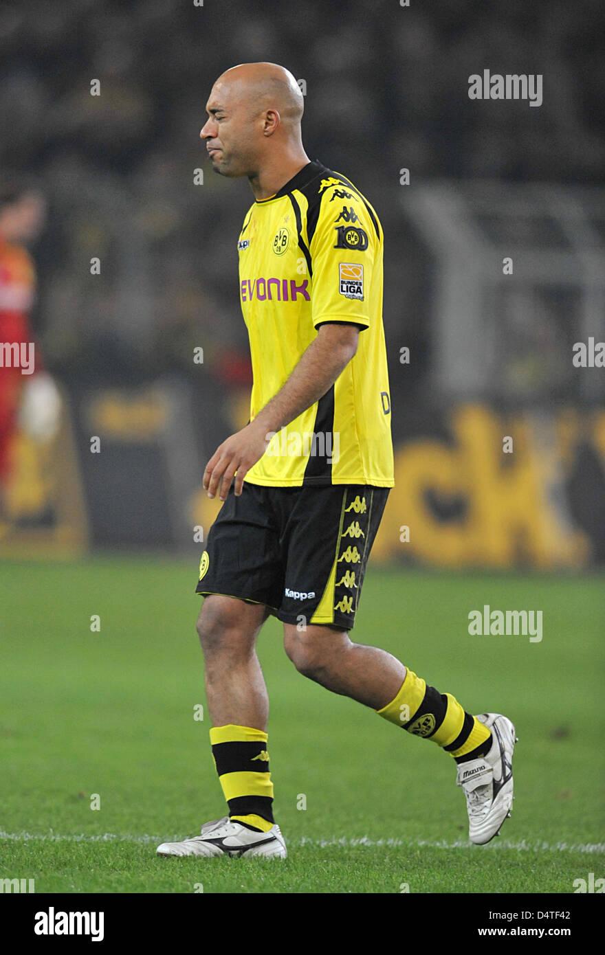 Dortmund?s Dede leaves the field after harming himself in a duel during the German Bundesliga match Borussia Dortmund - Stock Image