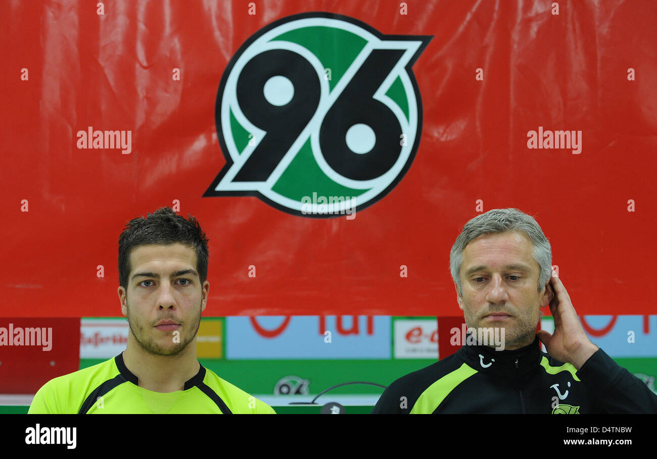 Goalkeeper Florian Fromlowitz (L) and head coach Andreas Bergmann of German Bundesliga soccer club Hanover 96 at - Stock Image