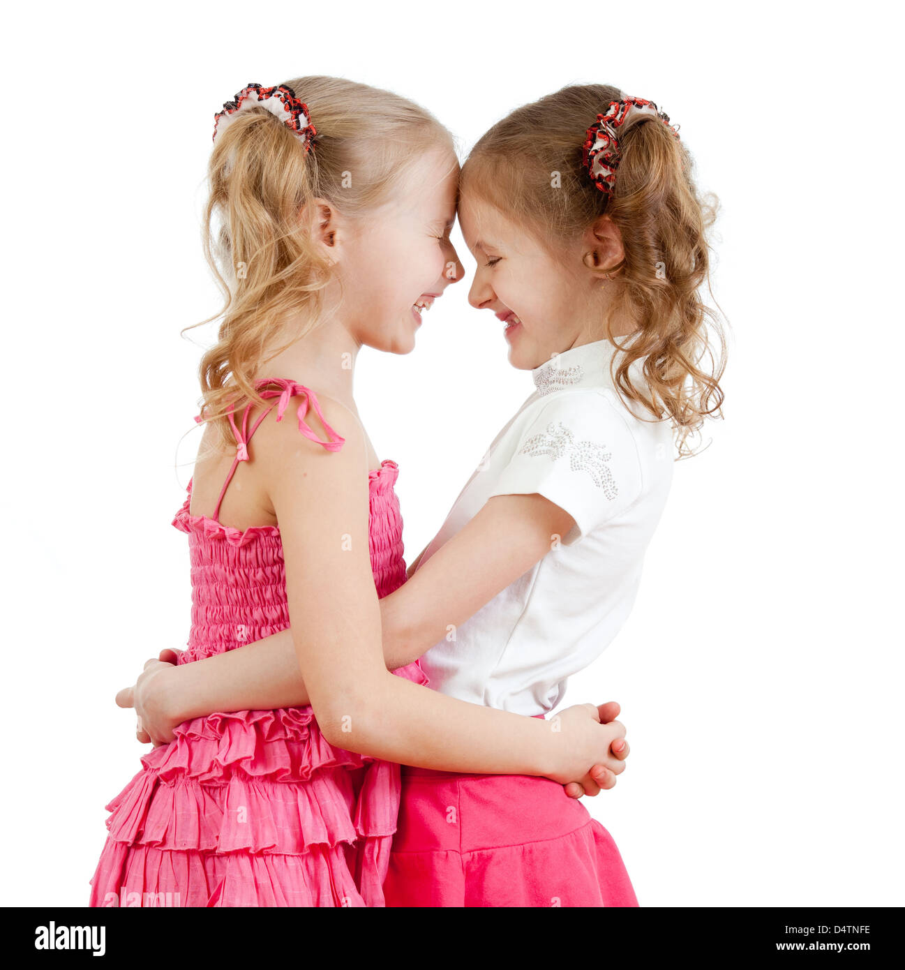 Smiling and hugging cute girls, best friends. - Stock Image