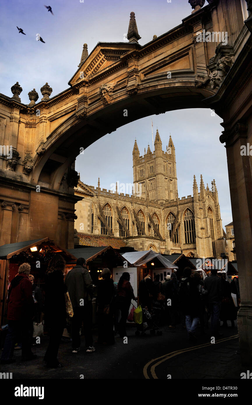 General view of Bath Abbey with the York Street arch during a Christmas market 2009 UK - Stock Image