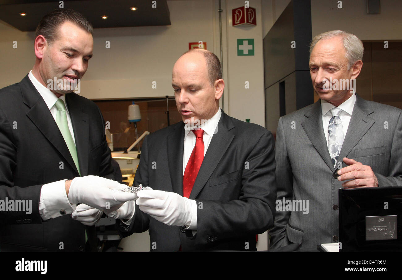 A Montblanc handout dated 23 November 2009 of Prince Albert II of Monaco (C) eyeing writing utensil 'Prince - Stock Image