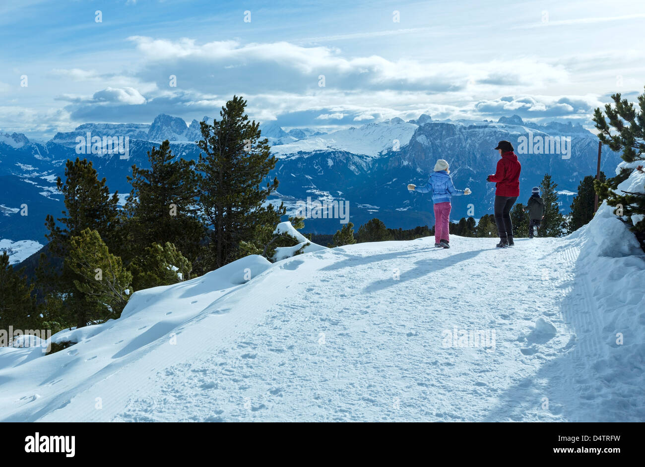 Family (mother with two children) take a walk on winter mountain slope (Rittner Horn, Italy) - Stock Image