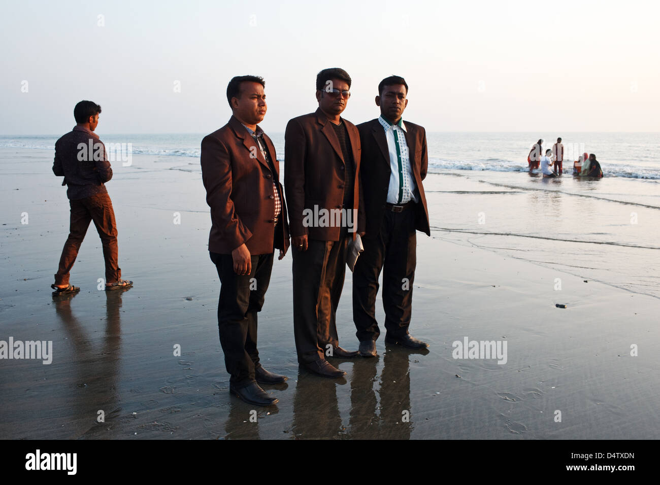 Bangladeshi visitors tourists on the beach in Cox's Bazar, Bangladesh Stock Photo