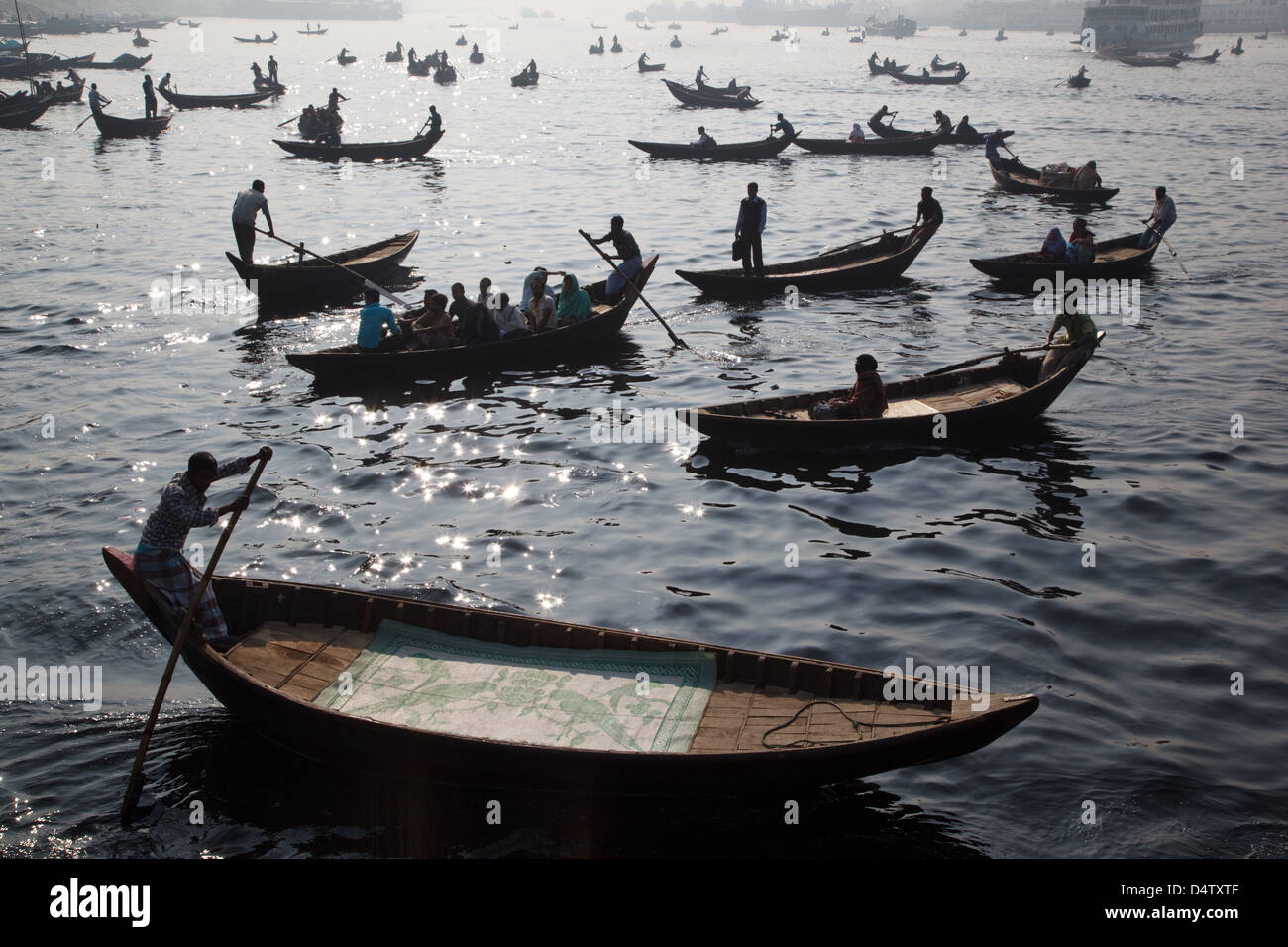 Taxi boats with commuters crossing Buriganga river, Dhaka, Bangladesh. - Stock Image
