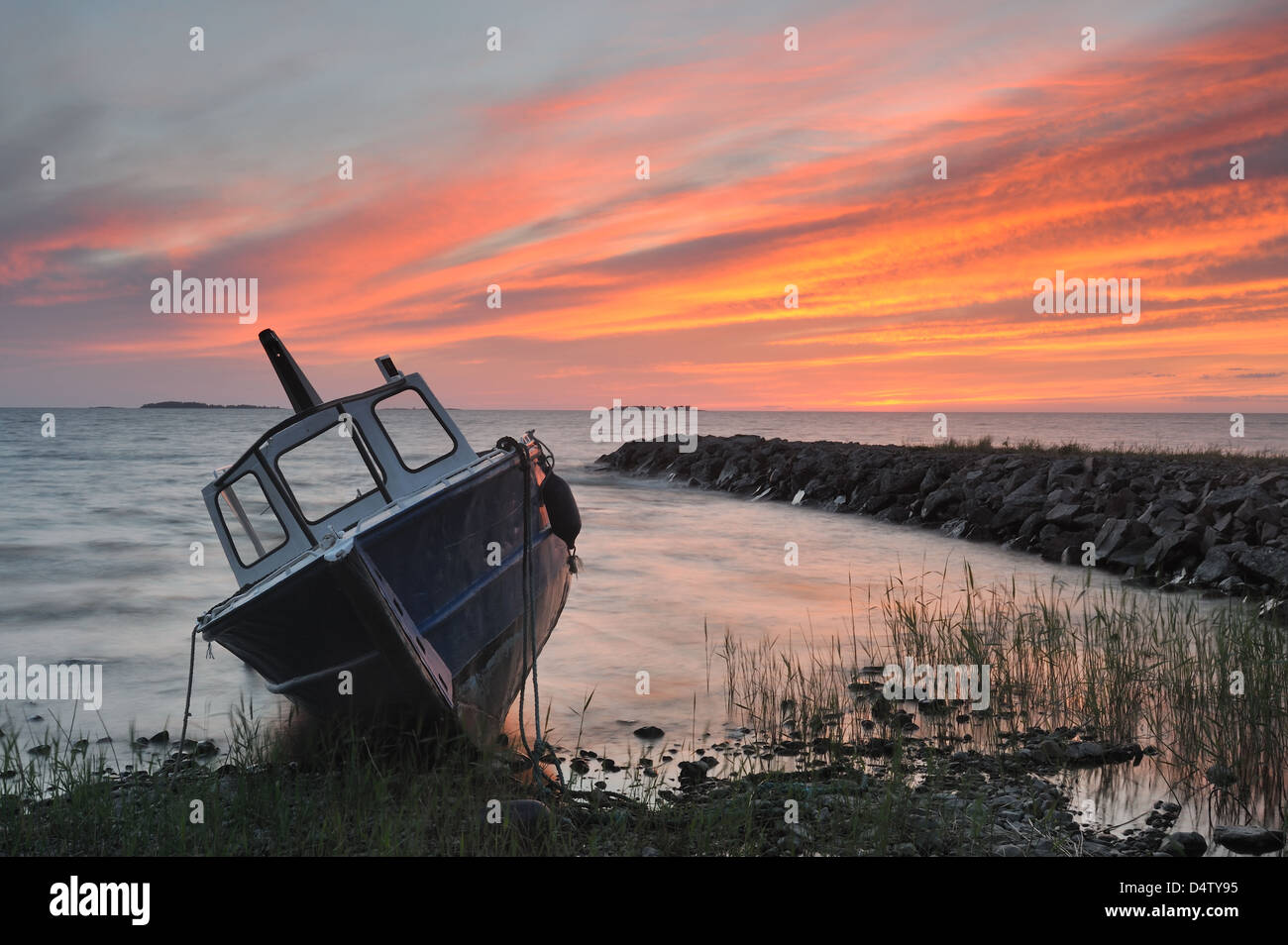 Moored fishing boat on shore, Vänern, Sweden, Europe - Stock Image