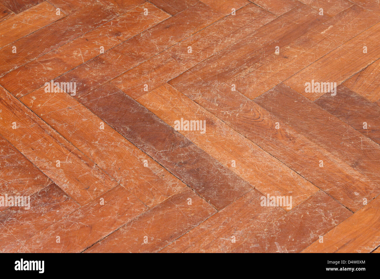 Old and scratched parquet floor surface - Stock Image