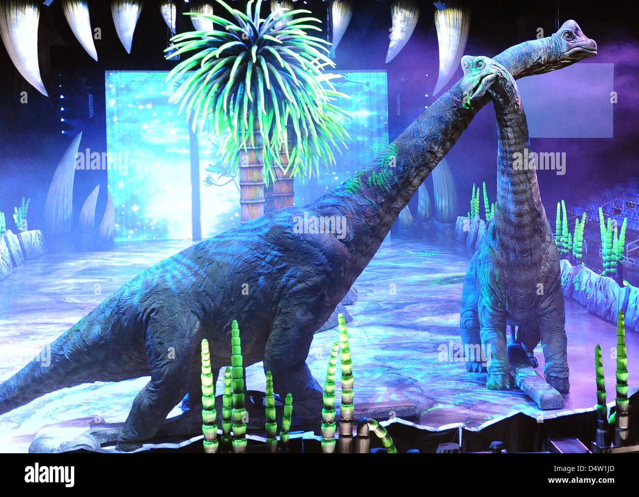 Dinosaurs appear in the German show 'Dinosaurier - Im Reich der Giganten' ('Dinosaurs - In the realm - Stock Image