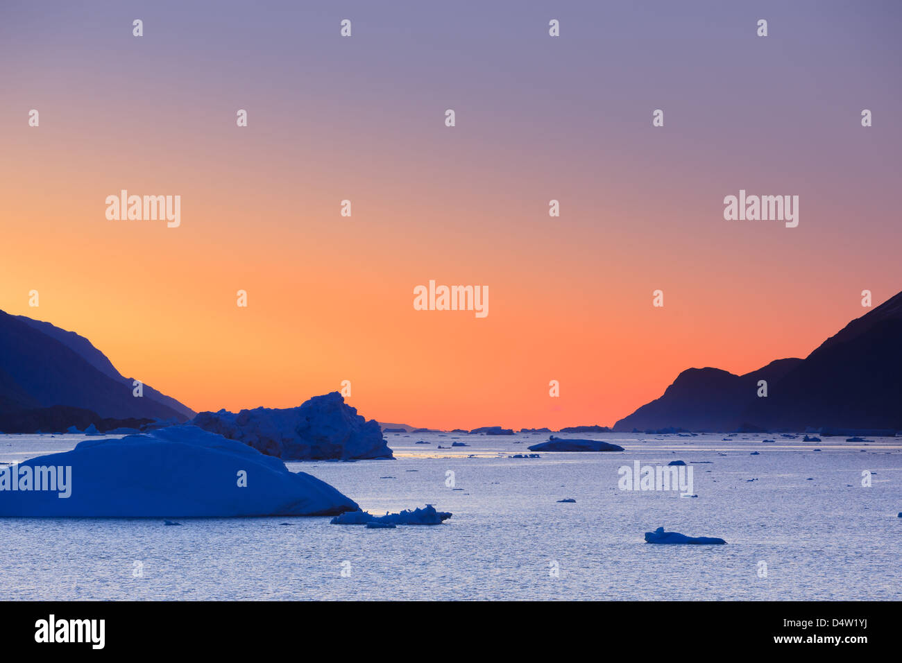 Icebergs at sunrise in the Rodefjord, Scoresby sund, Greenland - Stock Image