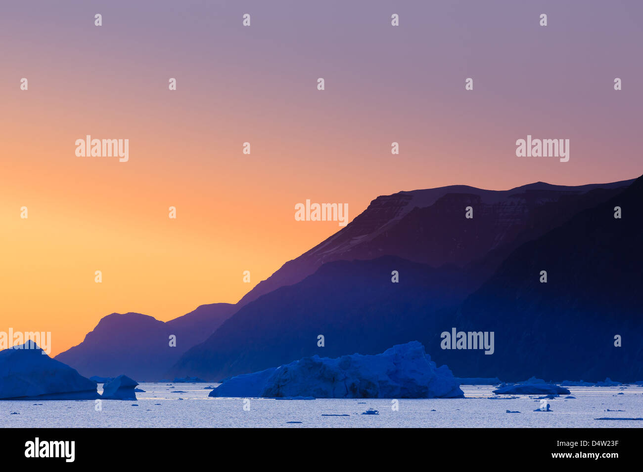 Icebergs at sunrise in the Rodefjord, Scoresbysund, Greenland - Stock Image