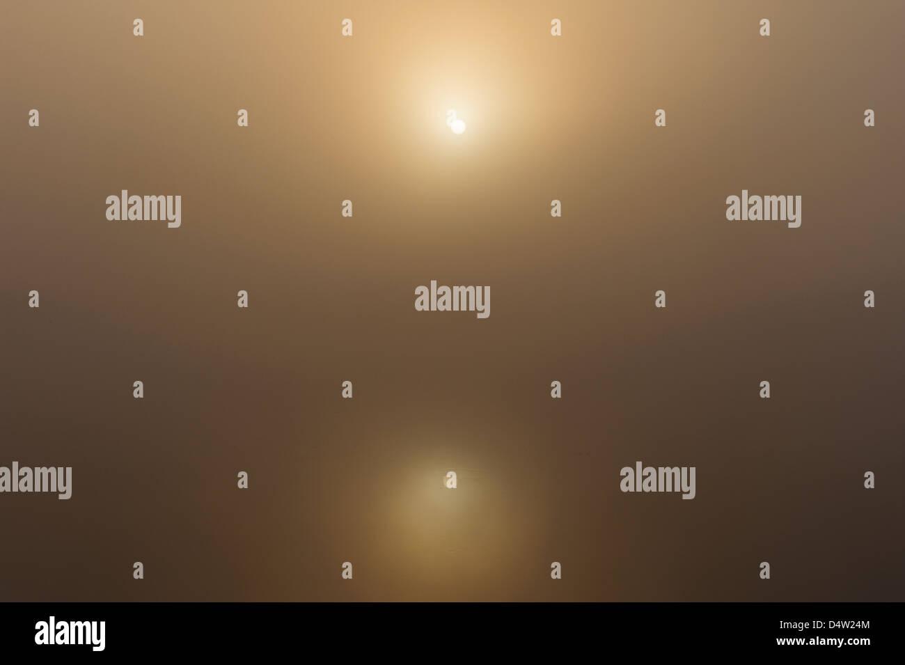 Autumn sun shining through fog over Göta Älv, Sweden, Europe - Stock Image