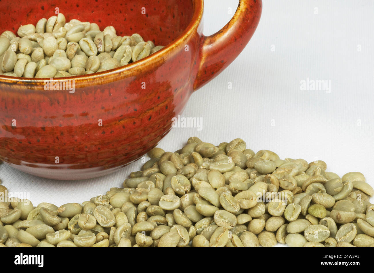 Green Coffee Beans With Red Mug - Stock Image