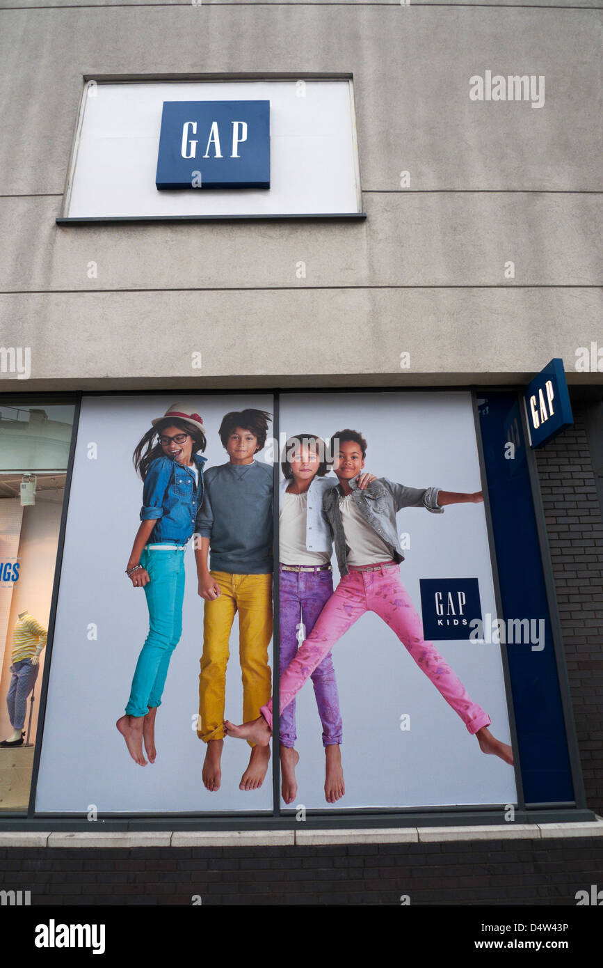 Gap clothing store advertisement with colourful bouncy pre teen children in colourful outfits for Spring 2013 London - Stock Image