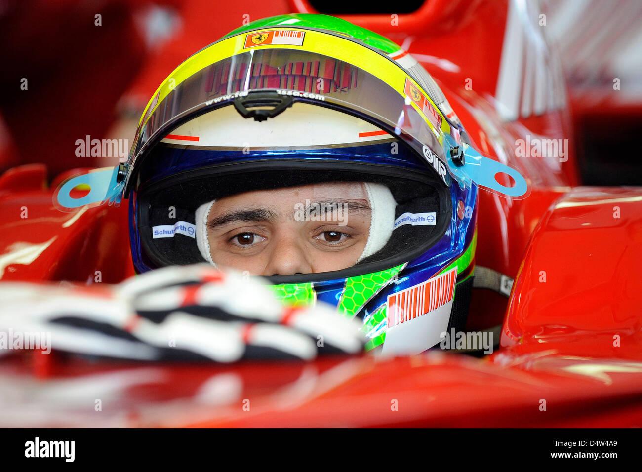 Brazilian Formula One driver Felipe Massa of Ferrari sits in a Ferrari F2007 race car at the Mugello test track - Stock Image