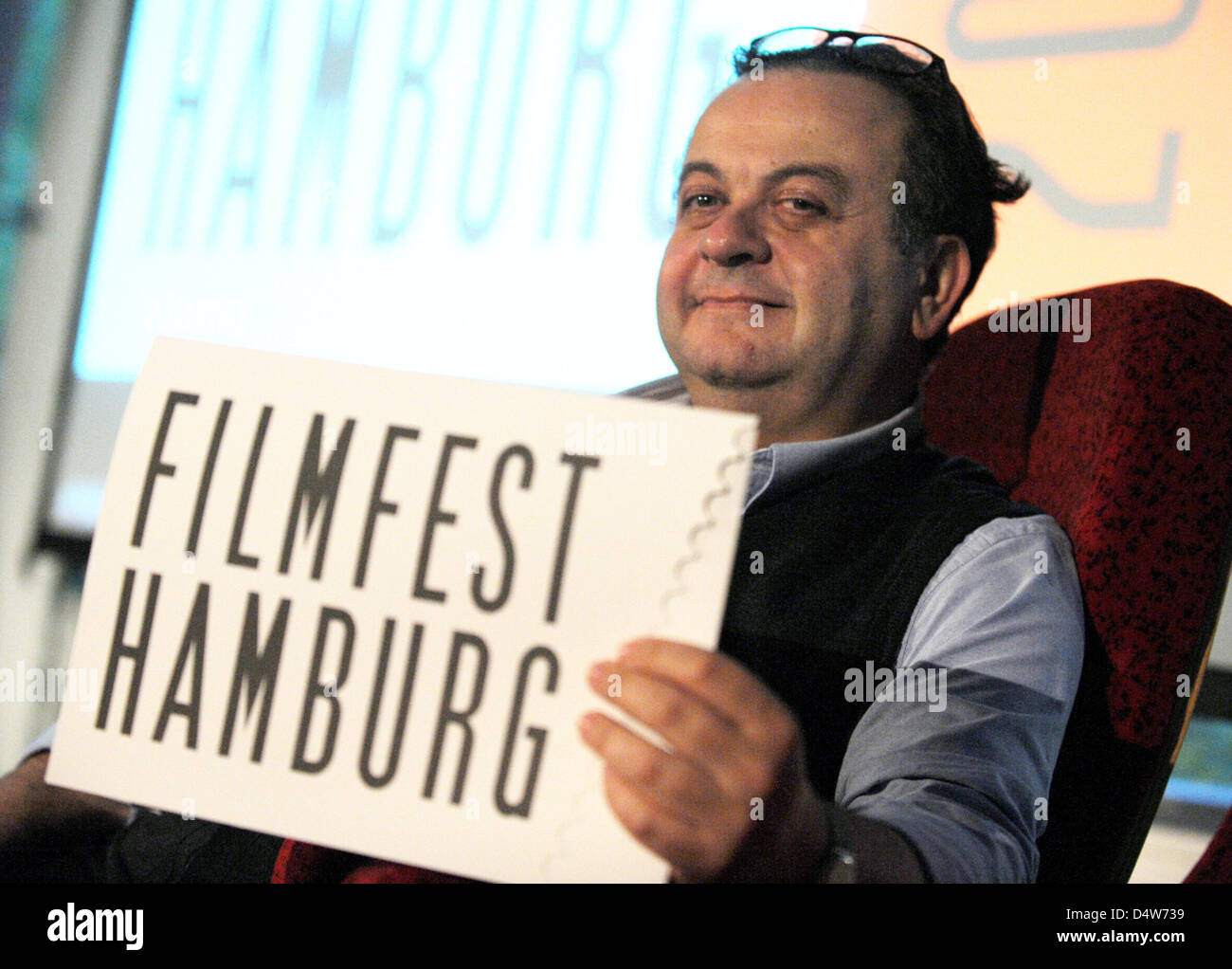 Head of the 18th Hamburg Film Festival, Albert Wiederspiegel, poses with a folder with the lettering 'Filmfest - Stock Image