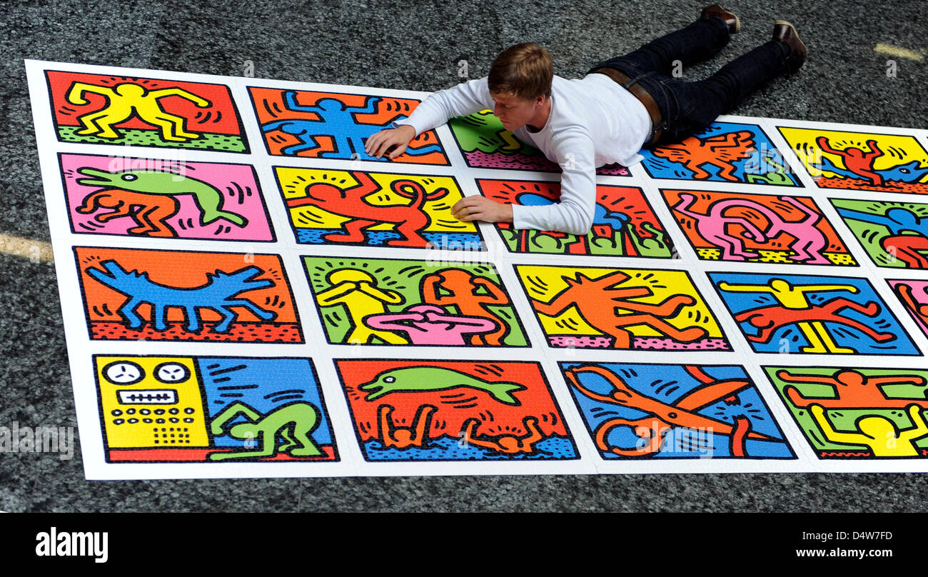giant puzzle  A Ravensburg AG employee enjoys a giant puzzle during the Stock ...