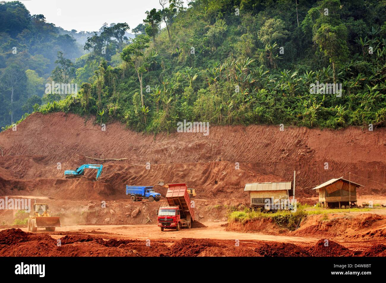 March 14, 2013 - Boten, Oudomxay, Laos - Construction equipment works on a car park being built to accommodate traffic Stock Photo