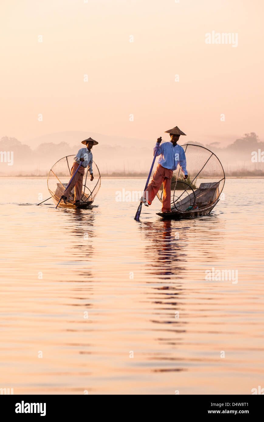 Traditional Intha fishermen on Inle Lake, Burma - Stock Image