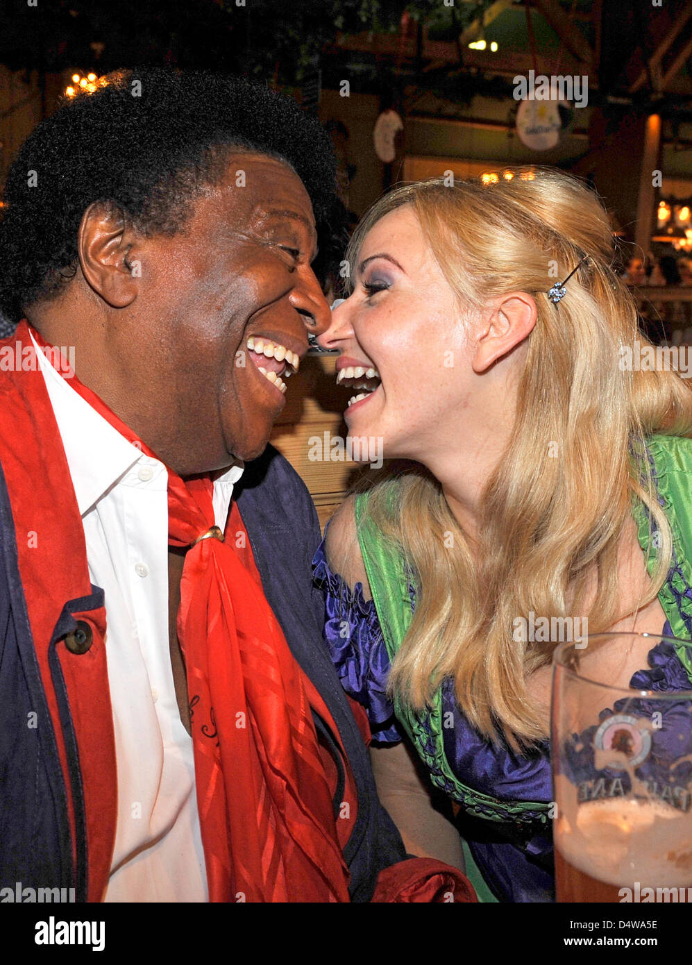 Entertainer and singer Roberto Blanco and his girlfriend Luzandra Strassburg celebrate at the Wiesn-meeting of the Stock Photo