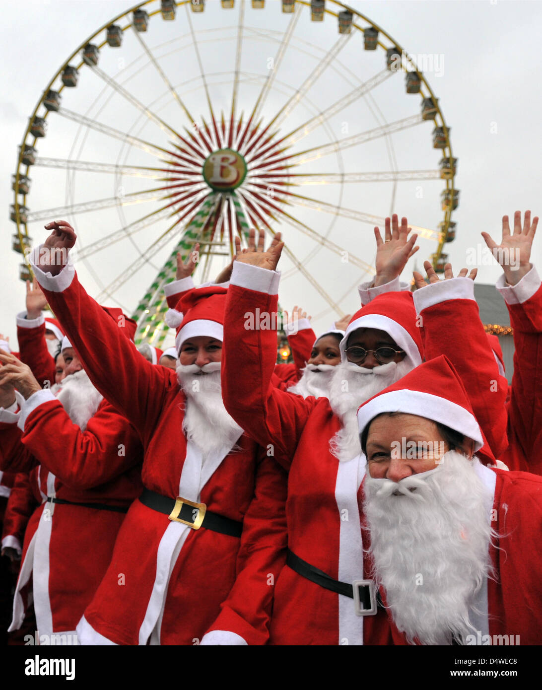 300 employees disguised as Santa Claus wave for the camera at the amusement park Europa-Park in Rust, Germany, - Stock Image