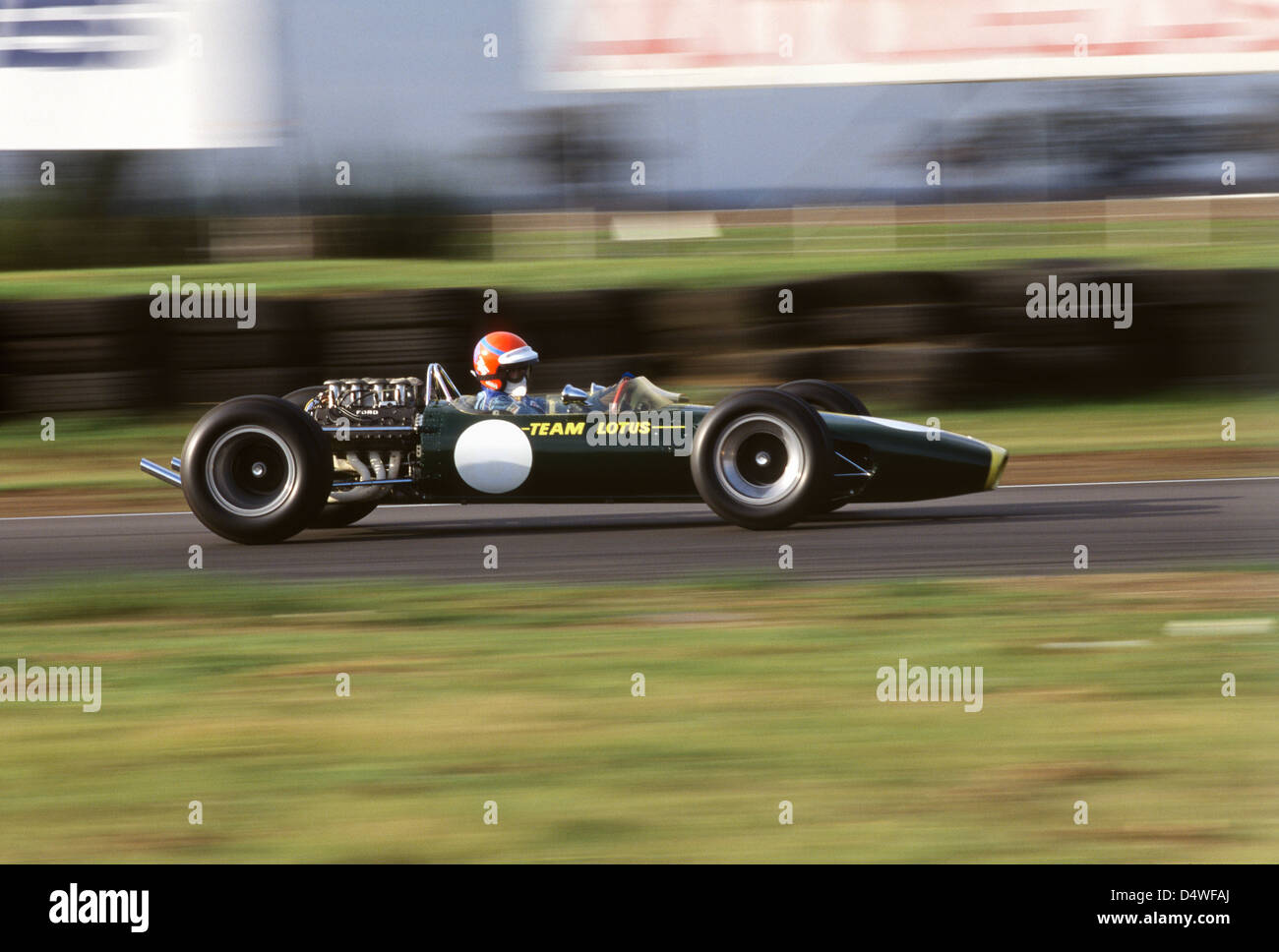 Graham Hill's Lotus 49, driven at Snetterton by Tiff Needell - Stock Image