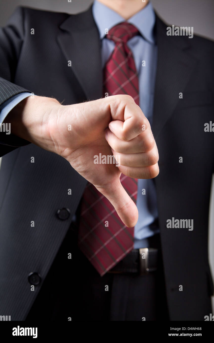 Businessman showing thumbs down - Stock Image