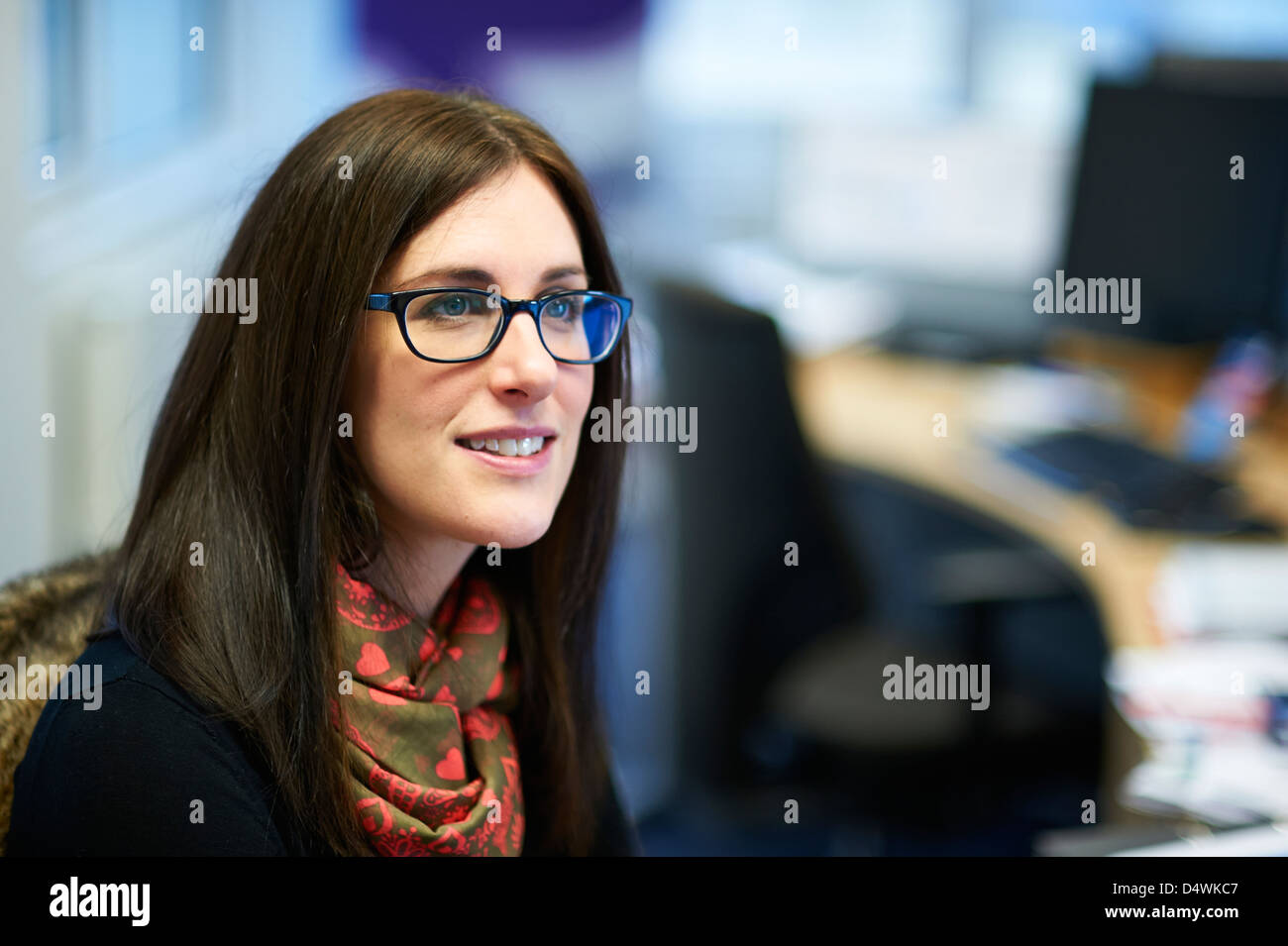 lady at desk - Stock Image
