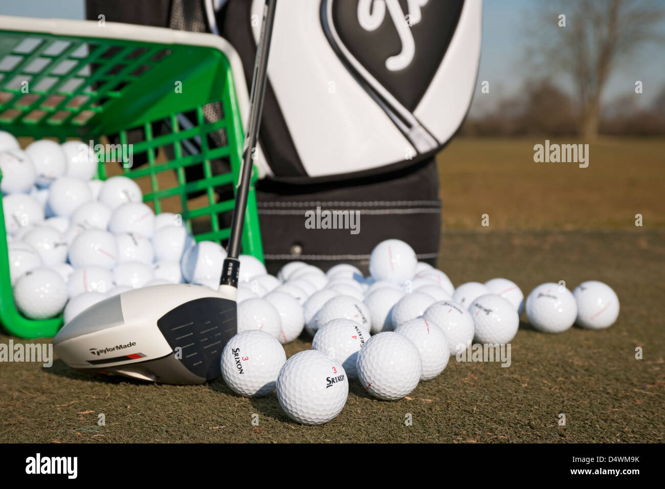 Golf range balls and driver on a golf practice ground England UK United Kingdom GB Great Britain - Stock Image