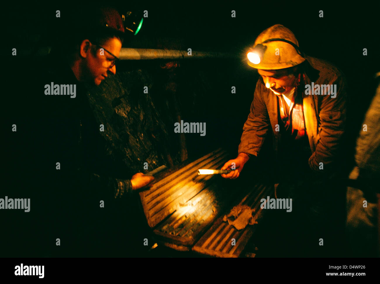 Two men inspecting core samples in the Red Lake Mine in Northern Ontario;Ontario;Canada - Stock Image