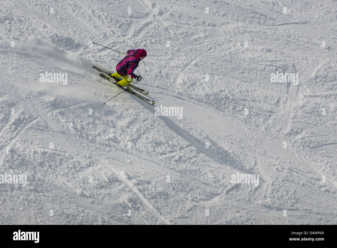 Mountain skier going down from a mountain slope - Stock Image