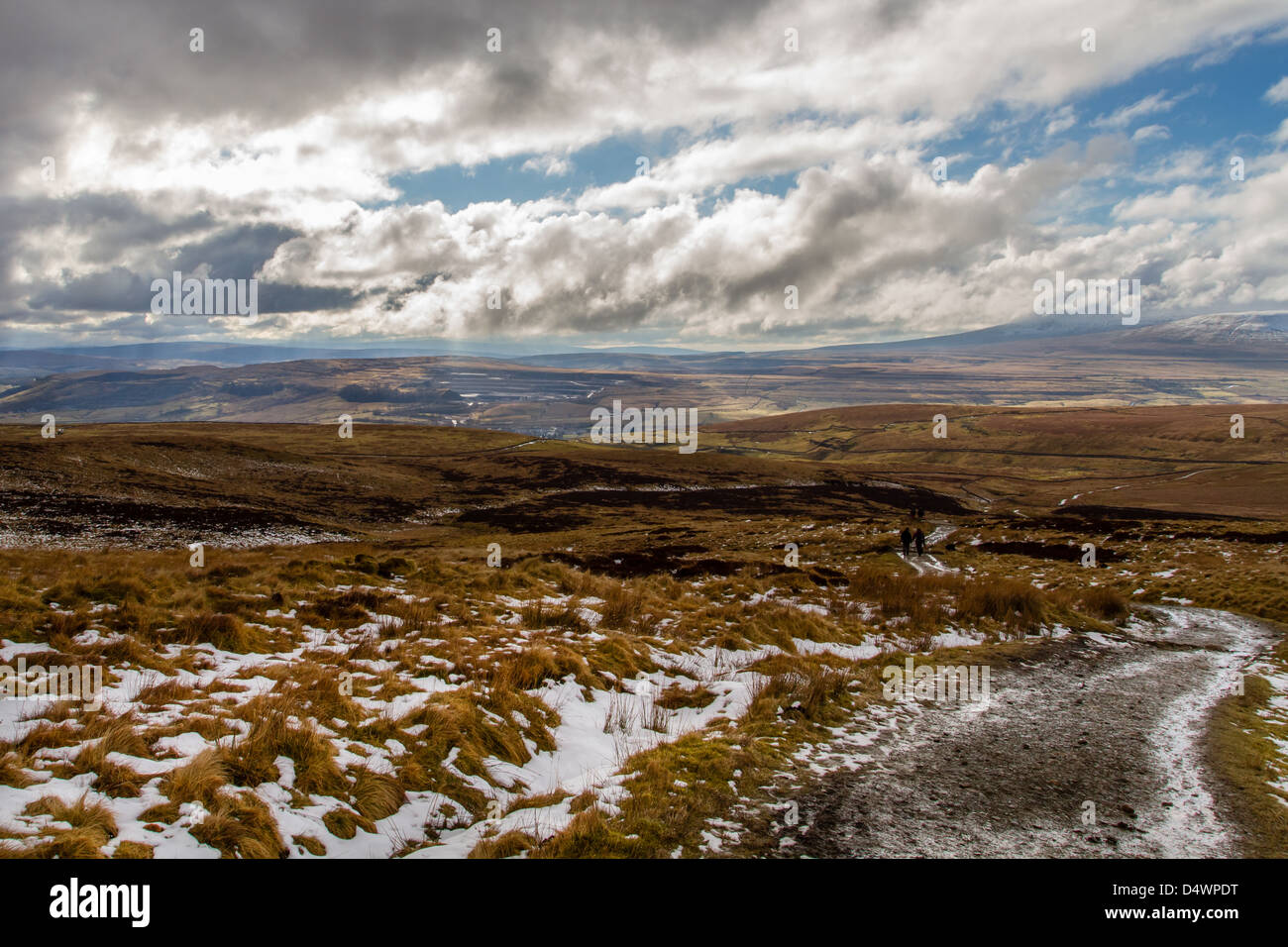 Heading down from Pen-y-Ghent, one of the Yorkshire 3 Peaks and looking over to the Ribblesdale Valley - Stock Image