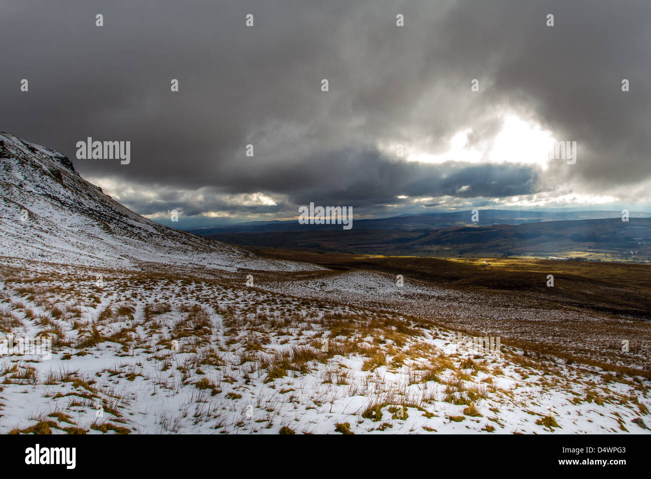Heading up Pen-y-Ghent, one of the Yorkshire 3 Peaks and looking over to the Ribblesdale Valley, UK - Stock Image