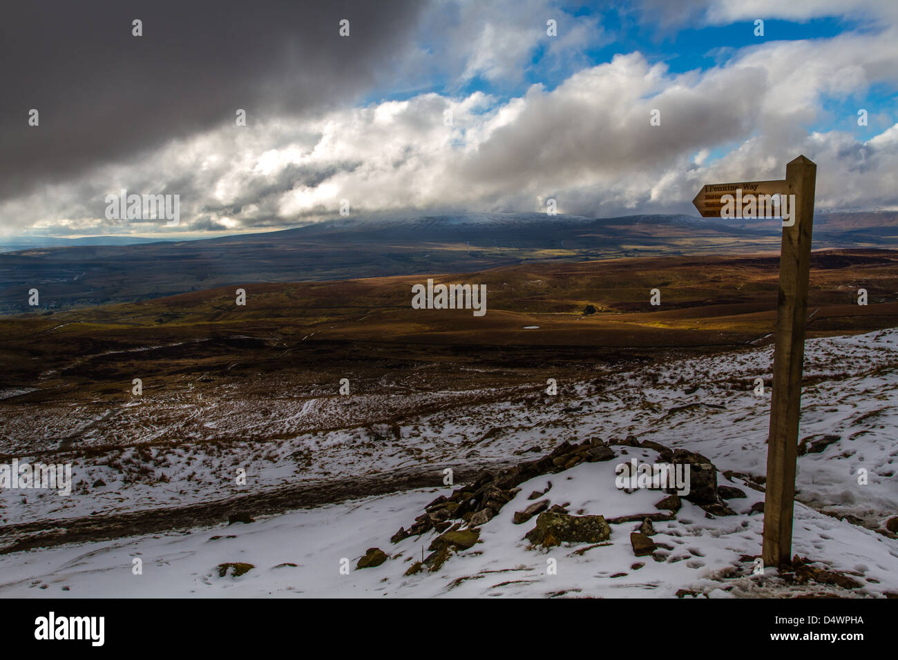 The way down from Pen-y-Ghent, marking the Pennine Way & the new routing of the Yorkshire 3 peaks - Stock Image