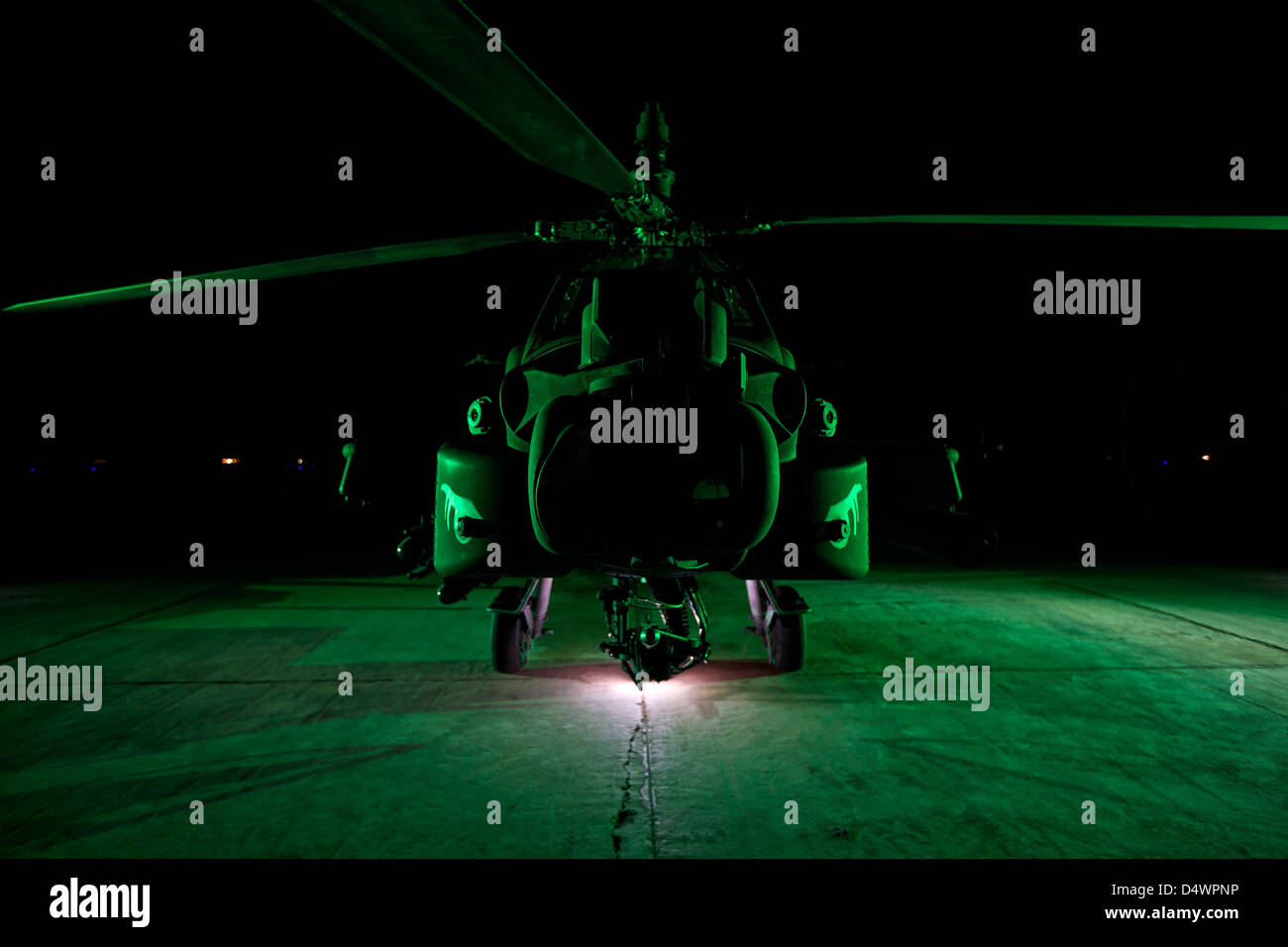 An AH-64D Apache Longbow parked at a military base in Tikrit, Iraq. - Stock Image