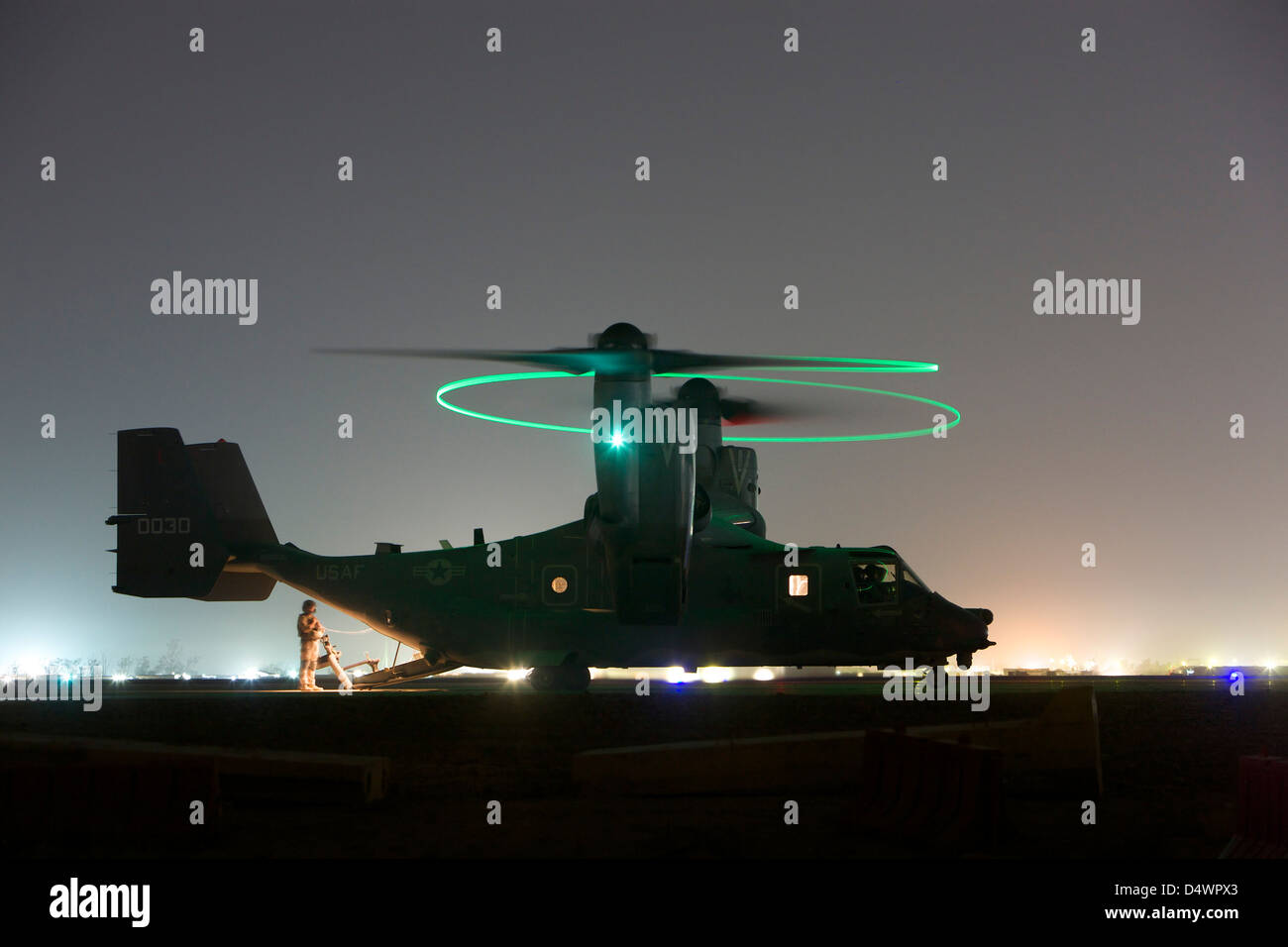 A special forces CV-22 Osprey with rotor lights on, preparing to take off on a mission over Northern Iraq. - Stock Image